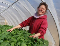 photo of Amy Newday in hoophouse